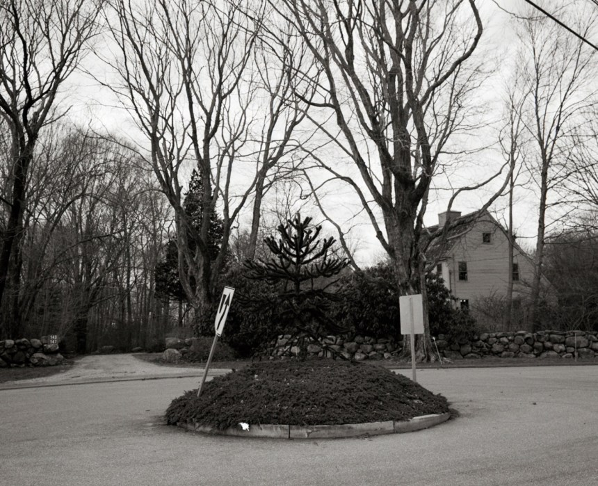 A statue of Captain John Mason used to stand in this traffic circle, in a quiet residential neighborhood Mystic, Conneticut. It was removed to his hometown of Windsor, Conneticut, in 1996.