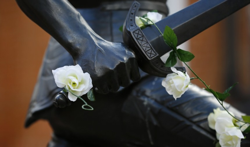 White roses adorn the King Richard III statue at Leicester Cathedral in central England.