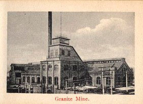 """Photo is part of a """"flip book"""" containing 12 photographs. This is photo 2 of 12. Shows Granite Mine with buildings and smokestack. Electric poles are present. Red ink at bottom of photo reads: """"Granite Mine."""" (http://cripplecreekmuseum.com/cgi-bin/photograph.cgi?id=2000127B)"""