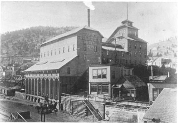 Exterior view of Gold Coin Gold Mining Company showing shaft house, and main buildings. Gold Coin Mine was located in Victor, Colorado. (http://cripplecreekmuseum.com/cgi-bin/photograph.cgi?id=A82-672A)