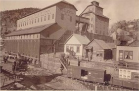 Exterior view of Gold Coin Gold Mining Company showing shaft house for number 3 shaft, and main buildings. Gold Coin Mine was located in Victor, Colorado. (http://cripplecreekmuseum.com/cgi-bin/photograph.cgi?id=CC-P-619A)