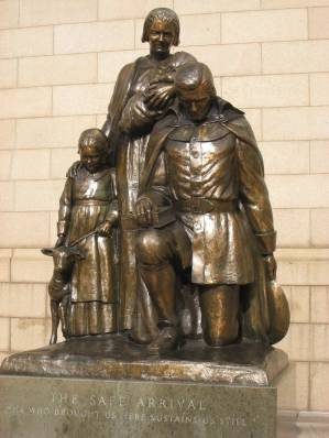 """""""The Safe Arrival"""", sculpture by Frances Laughlin Wadsworth, outside the Travelers headquarters, Hartford, Connecticut (dedicated 27 Apr 1964). The inscription, """"He who brought us here sustains us still"""" (Qui Transtulit Sustinet), is the State motto of Connecticut."""