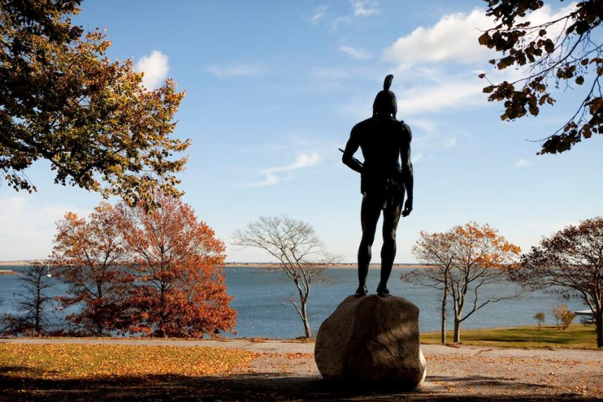 A statue of Massasoit overlooks Plymouth Harbor in 2013. (Melanie Stetson Freeman / The Christian Science Monitor / Getty)