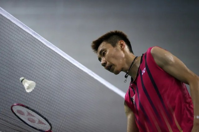 Malaysia's Lee Chong Wei is pictured at the net during his men's singles semi-final badminton match against China's Lin Dan at Gyeyang Gymnasium at the 17th Asian Games in Incheon