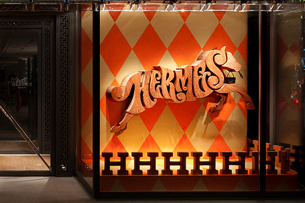 maison hermes tokyo alphabetic equestrian by house industries display window