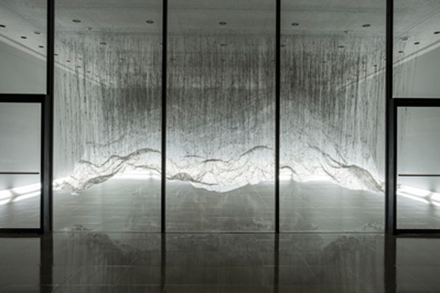 Hot Black Glue and White Sheeting Go a Long Ways In This Amazing Installation