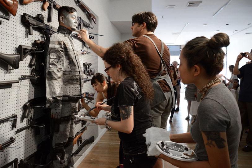 Liu Bolin's Gun Rack Performance @ Eli Klein Fine Art Gallery New York