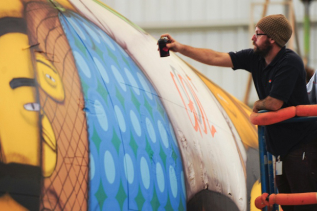 Os Gêmeos Spray Paint the Brazillian National Team's Airplane