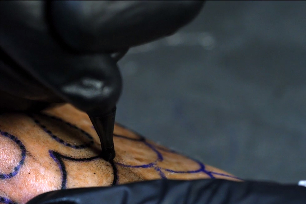 A Mesmerizing Video of a Tattoo Gun in Slow Motion