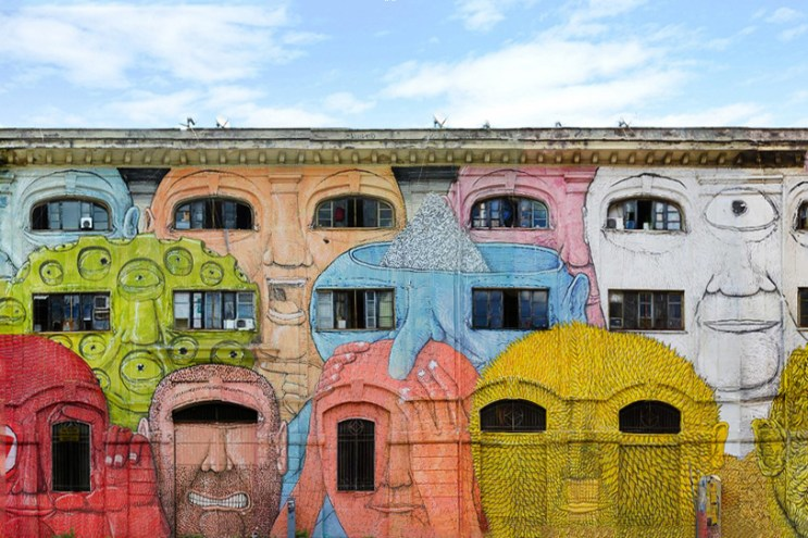 BLU Animates Wall Structures into Faces for his Mural in Rome