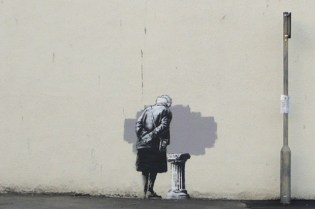 """Removal of Banksy's """"Art Buff"""" Mural Stirs Protests"""