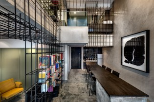 A Look Inside the Singapore Loft Unified by a Giant Cage