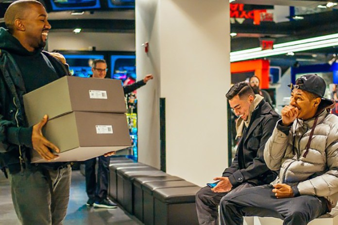 Kanye West Puts On a Smile and Hand Delivers the First Pairs of Yeezy Boost