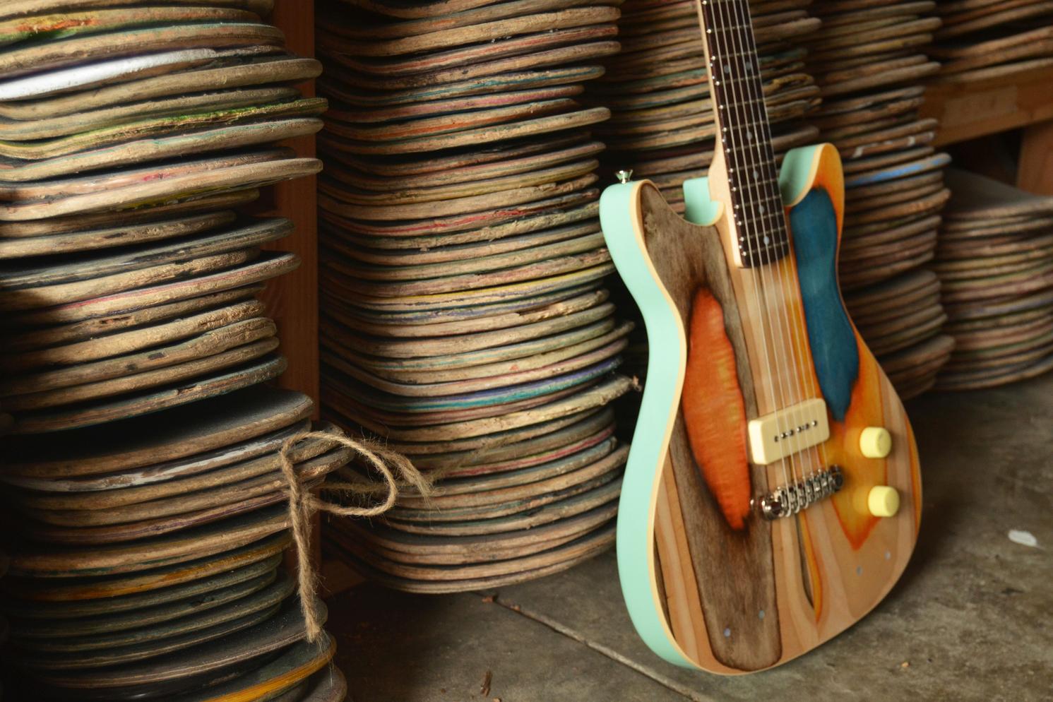 Designer Nick Pourfard Upcycles Skate Decks Into Colorful Guitars