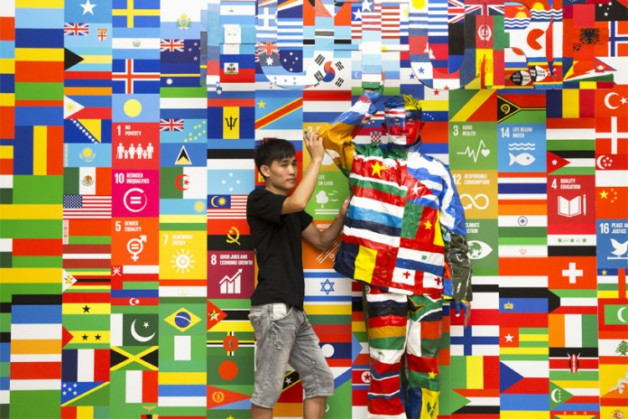 Liu Bolin Camouflages Himself Against 193 UN Flags for the Global Goals Campaign