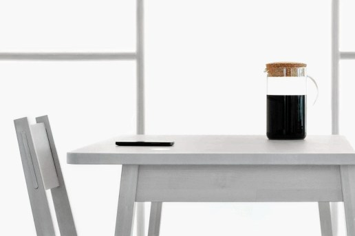 This IKEA Kitchen Table Wirelessly Charges Your Phone Using Heat From a Saucepan