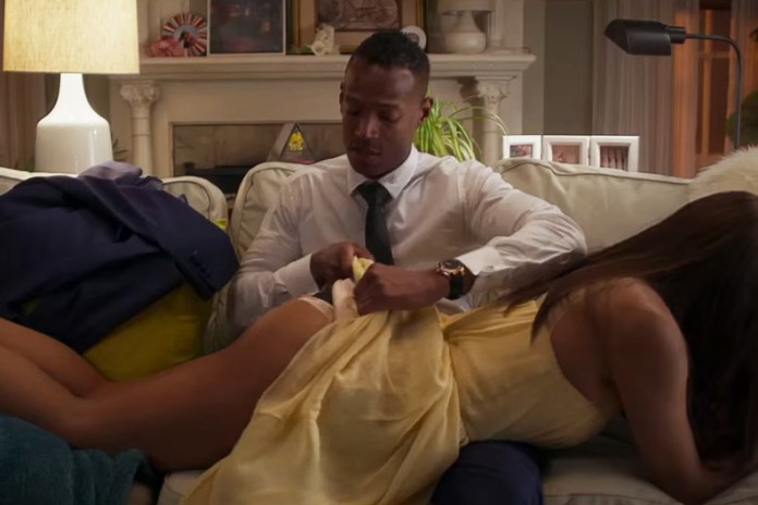 Marlon wayans opens a door with a key in fifty shades of black red