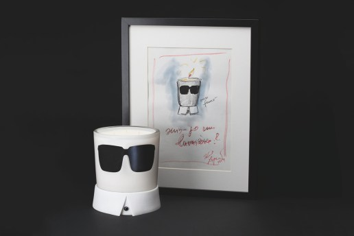 Karl Lagerfeld Transforms Into a Candle This Christmas