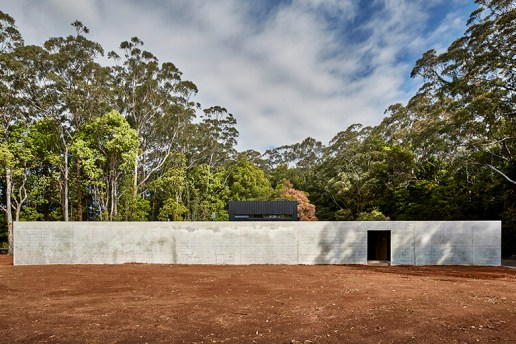 Modscape's Brick Wall Conceals a Modular Poolside Home in Australia