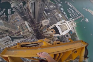 Watch This Guy Free-Climb the World's Tallest Residential Building in Dubai