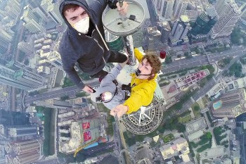 These Three Daredevils Climbed the Enormous 1,260-Foot Shun Hing Tower