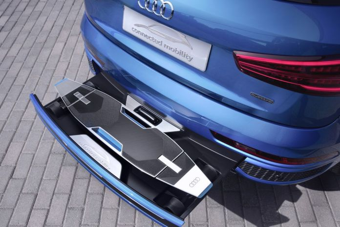 Audi Packed an Electric, Autonomous Longboard Into the Bumper of Its Q3 SUV