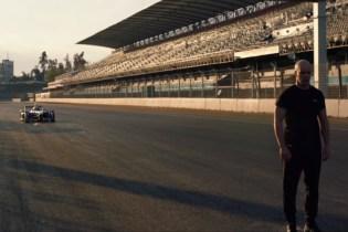 Watch This Stuntman Attempt a Blind Backflip Over a Speeding Racecar