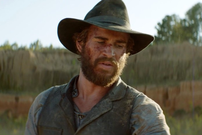 Liam Hemsworth & Woody Harrelson Face off in 'The Duel'