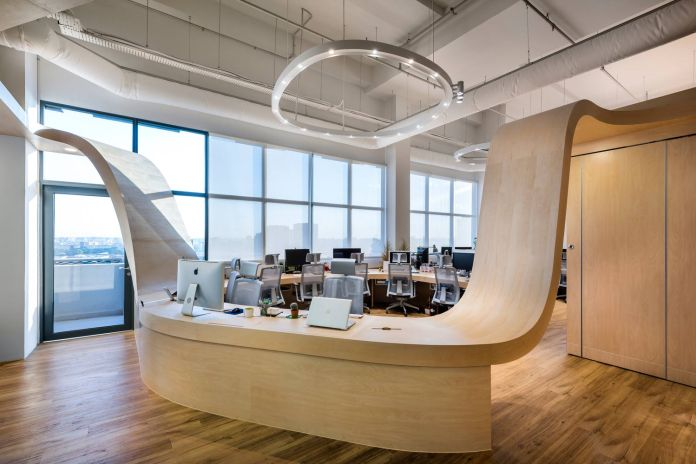 This Workspace Was Built Around a Single Undulating Desk