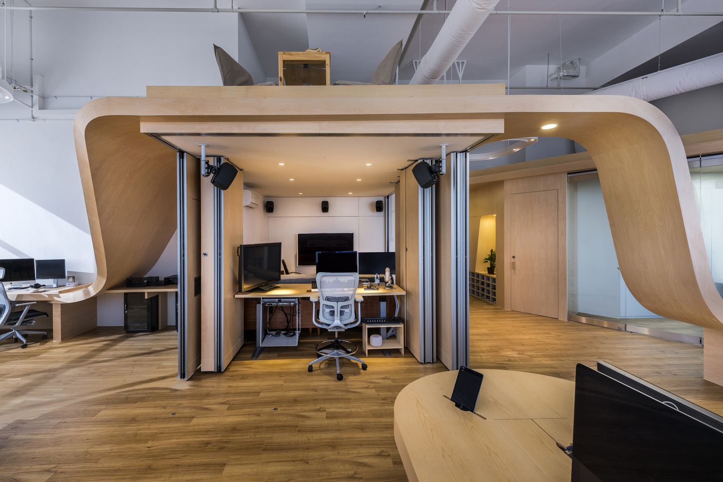 This Workspace Was Built Around a Single Undulating Desk