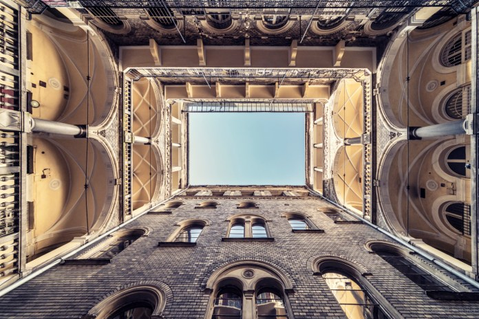 Zsolt Hlinka's '100-Year-Old House' Photo Series Transforms Budapest's Historic Landmarks Into Tunnels to the Sky