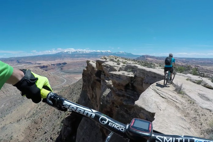 Watch These Daredevils Mountain Bike Along a 400-Foot Cliff