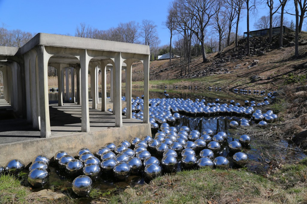 Yayoi Kusama Floats 1,300 Spheres to Create an Ever-Changing Landscape Installation