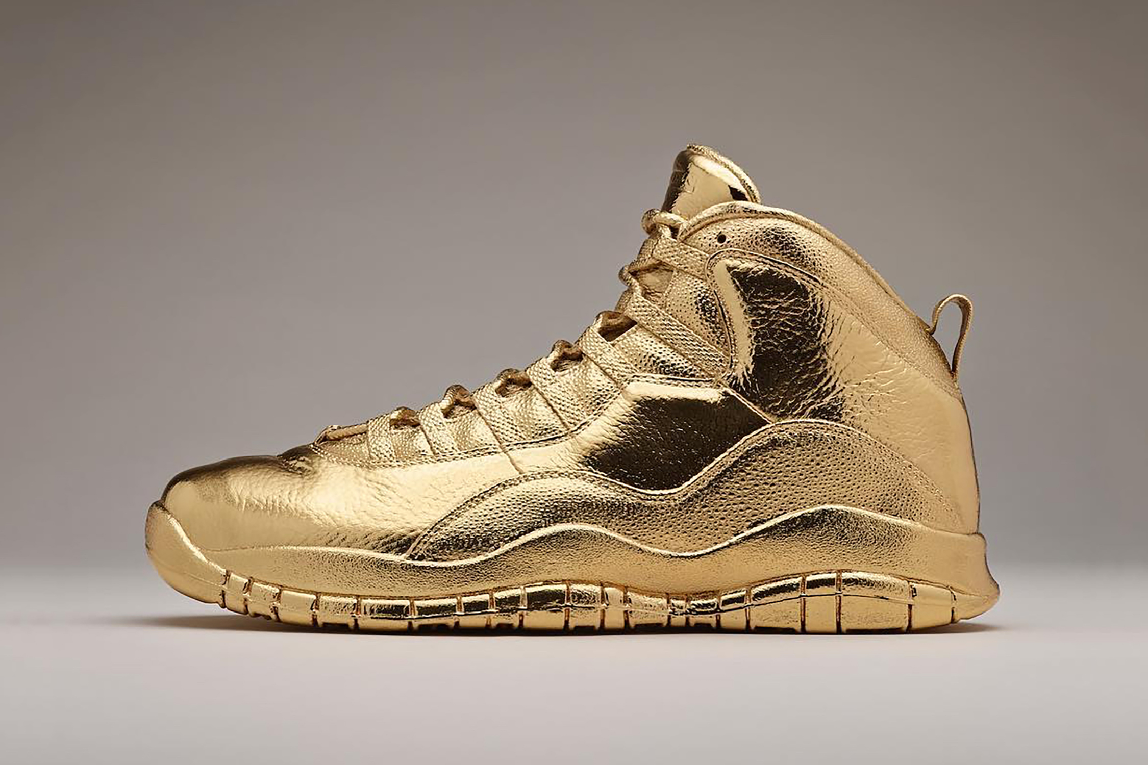"Check out Drake's Solid Gold Air Jordan 10 ""OVO"" Sneakers"