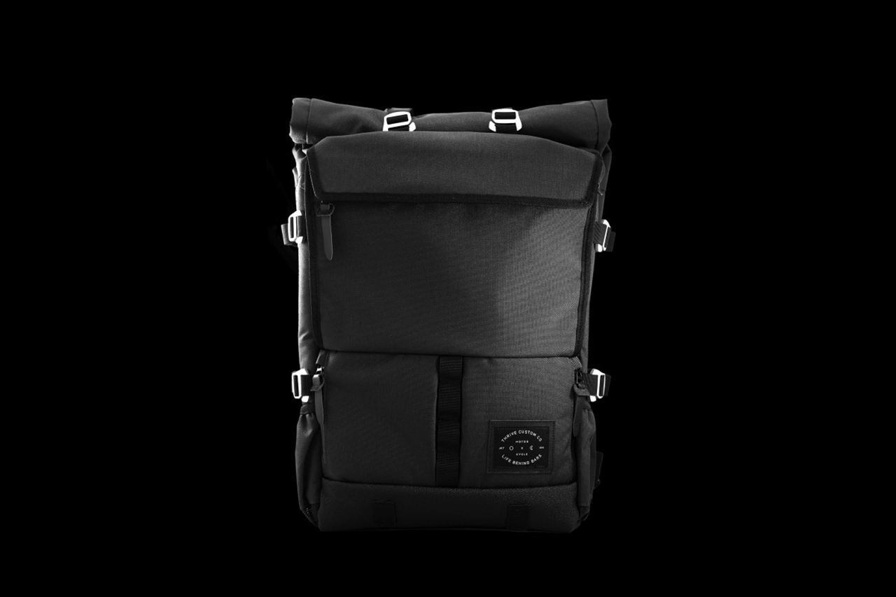 """Life Behind Bars Collaborates With Thrive Motorcycles on """"The Peloton ASPHALT"""" Backpack"""