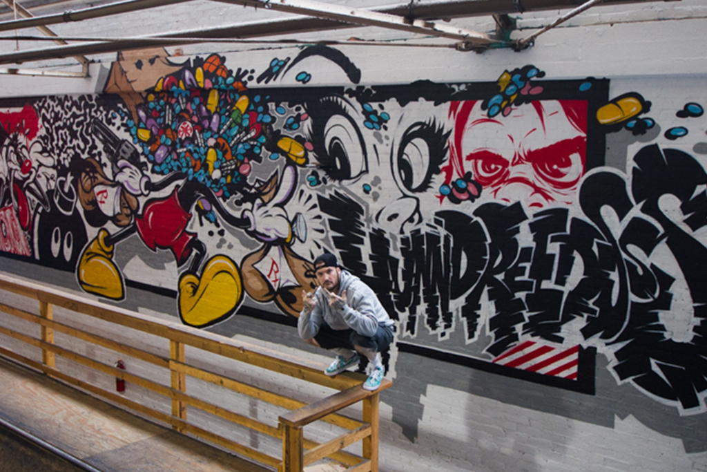 "2Shae ""Pill Head"" Paints a Vibrant Mural at The Hundreds HQ"