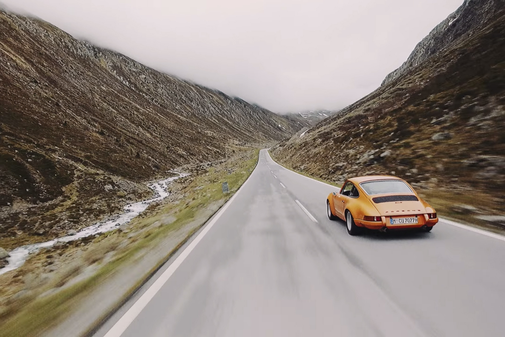 Watch Nine Glorious Porsches Weave Majestically Through the Alps