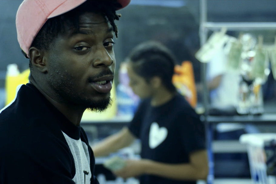 "TDE's Isaiah Rashad Taps Into the Hustler Mentality for His ""Free Lunch"" Music Video"