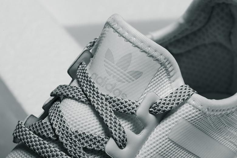Adidas Originals NMD R1 Glitch Camo Core Black Orange Red Grey