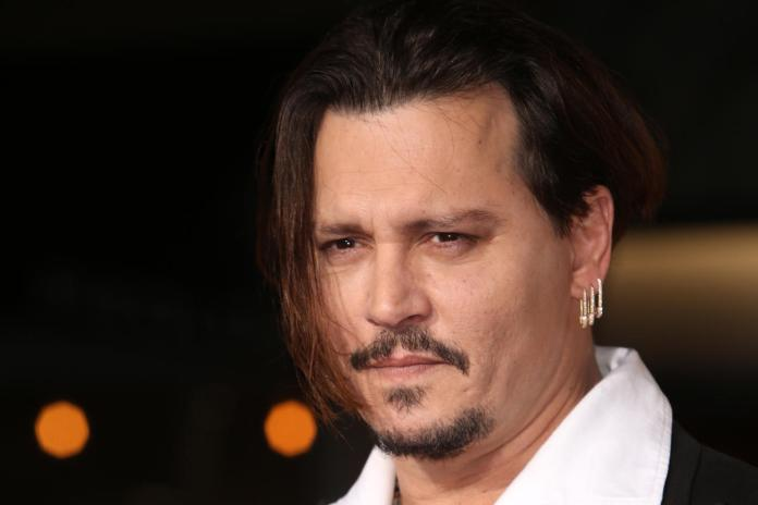 Johnny Depp Is Going to Try to Solve Biggie & Tupac's Murders