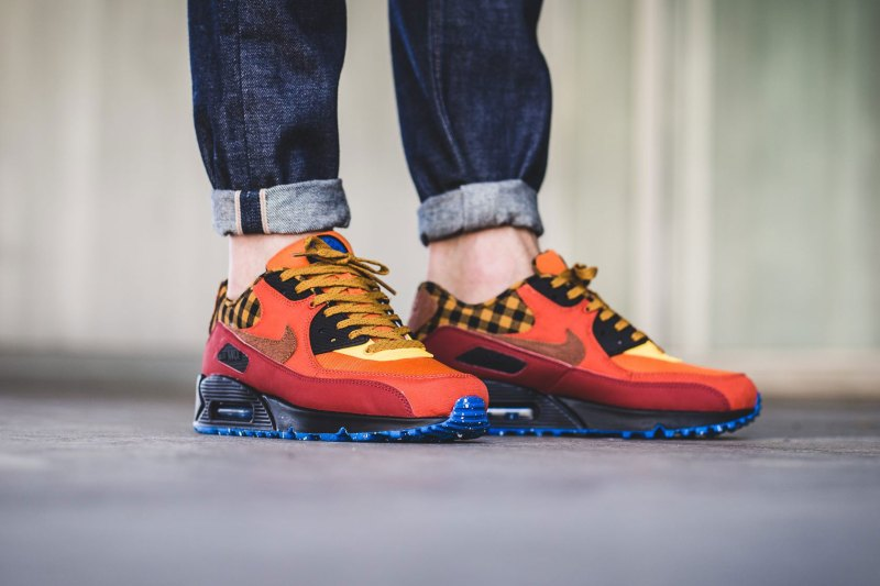 b08db10249 Nike's classic Air Max 90 silhouette gets a Fall-ready bonfire-inspired  colorway. With a well-executed melange of orange, red, burnt sienna, blue  and brown, ...