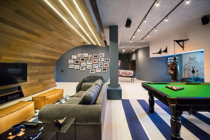 """A Teen's Basement Tranforms Into a """"Man Cave"""" for Skateboarders"""