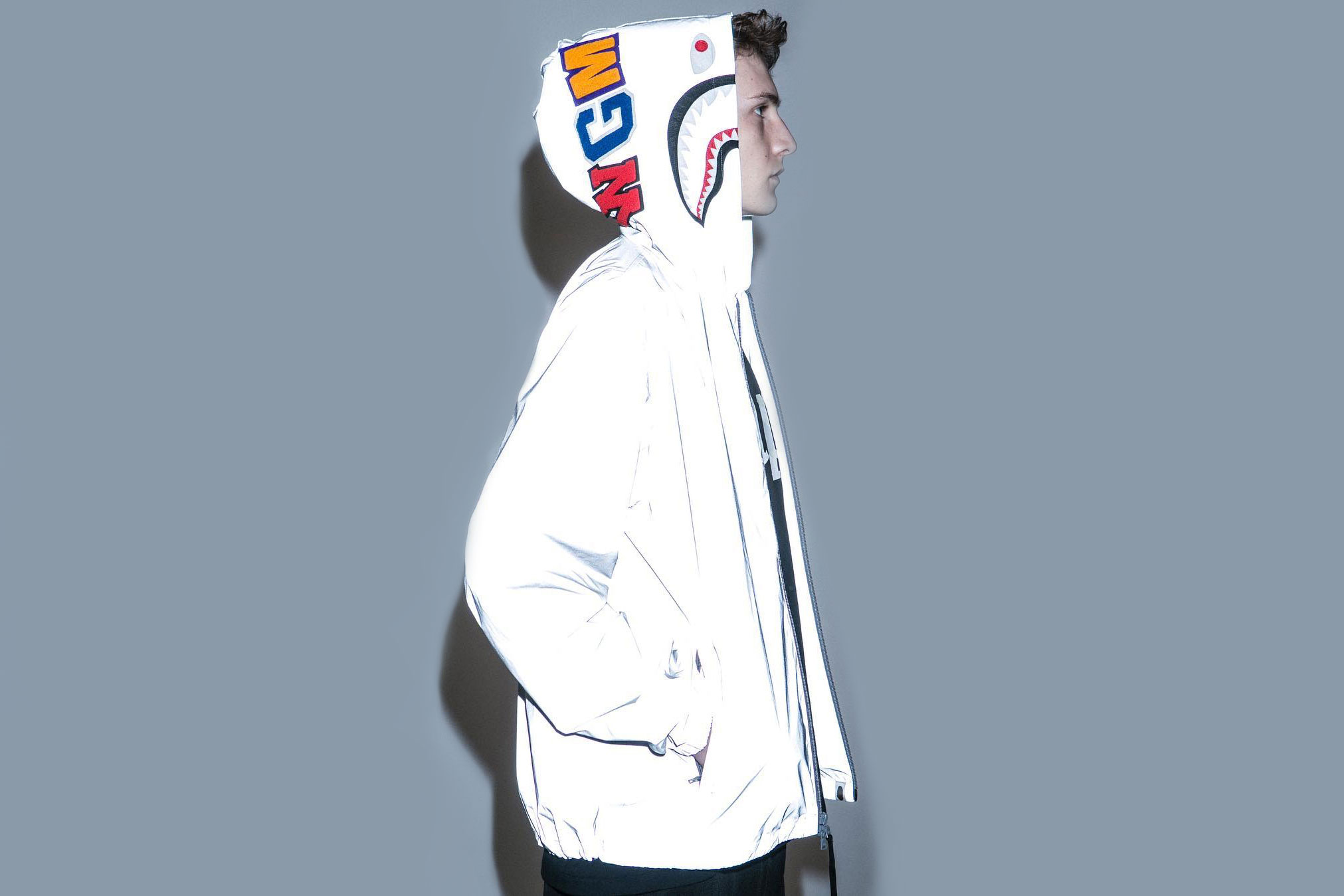 Stand out in BAPE's Reflector Shark Hoodie Jacket
