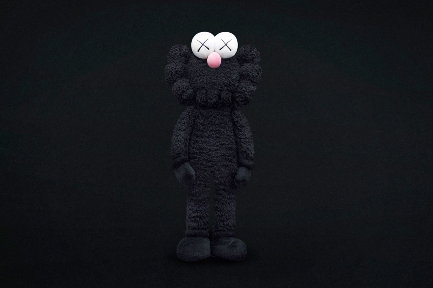 KAWS Unveils Black BFF Statue And Merchandise At The ...