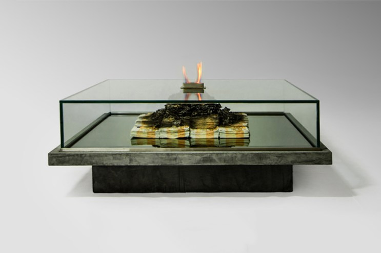 This Glass Coffee Table Features a Large Heap of Burning Money