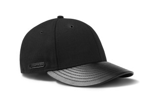 Killspencer Teams Up with New Era to Create Minimalist All-Black Cap Collection