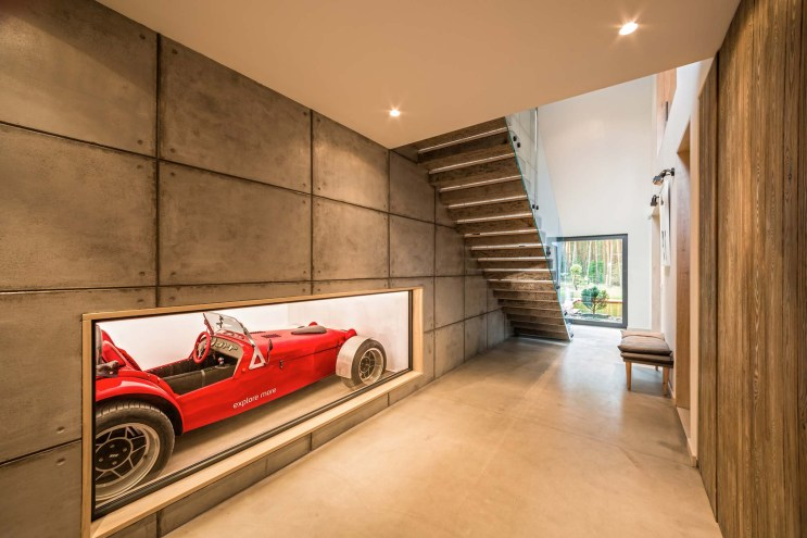 """This Gorgeous """"Fence House"""" in Poland Boasts Two Abodes in One"""