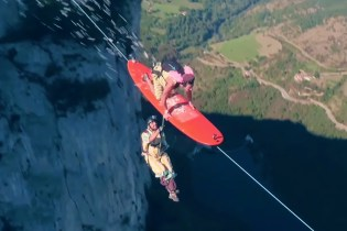 Watch a Group of Daredevils Surf a Zipline Over 2,000 Feet in the Air