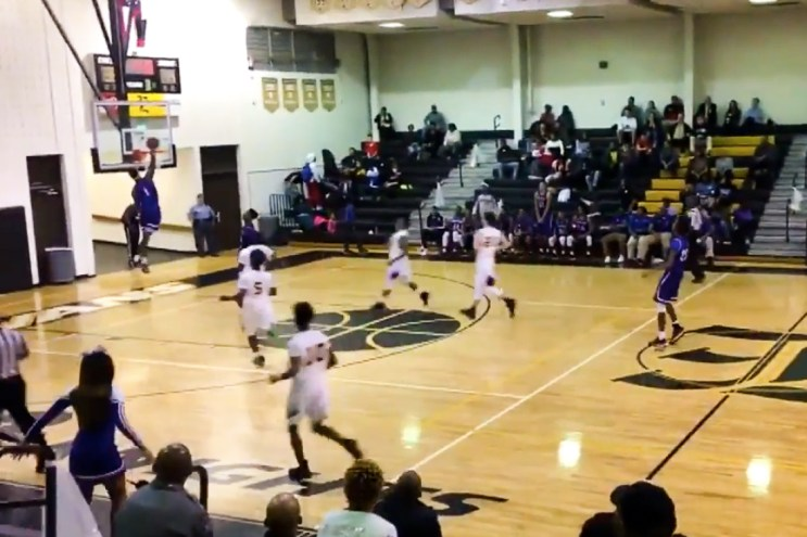 High School Basketball Player Shatters Backboard With Fast-Break Dunk