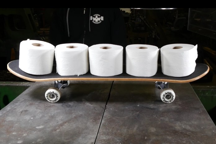 Watch a Hydraulic Press Turn 20 Rolls of Toilet Paper Into a Skateboard